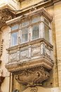 Old traditional wooden balcony and facade in the valletta malta Stock Photo