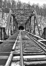 Old train bridge and tunnel in snow Royalty Free Stock Photo