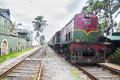 Old train with new paint st run coloures and runing time to colombo srilanka on in galkissa srilanka Stock Photos