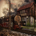 Old train and ruined station by the in a foggy landscape Stock Image