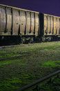 Old train wagons by night Royalty Free Stock Images