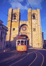 Old tram in lisbon traditional yellow front of the cathedral of portugal Royalty Free Stock Photos