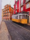 Old tram in lisbon traditional yellow on the street of portugal Royalty Free Stock Photo