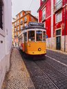 Old tram in lisbon traditional yellow on the street of portugal Royalty Free Stock Image