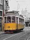 Old tram in lisbon traditional yellow on the street of portugal Royalty Free Stock Photos