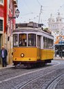 Old tram in lisbon traditional yellow on the street of portugal Stock Photo
