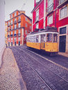 Old tram in lisbon traditional yellow on the street of portugal Stock Image