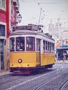 Old tram in lisbon traditional yellow on the street of portugal Stock Photography