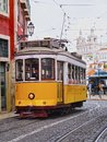 Old tram in lisbon traditional yellow on the street of portugal Stock Images