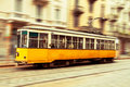 Old tram in motion yellow from milan italy regular service moving at high speed blurred background Royalty Free Stock Images