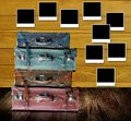 Old travel bags with photo frames post on wooden wall retro concept Royalty Free Stock Images