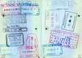 Old travel passport with visa stamps Stock Photo