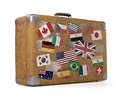 Old traveled bag antique suitcase with stamps flags representing each country clipping path included Royalty Free Stock Images