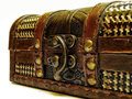 Old treasure chest detail of with gold chain isolated over white background Stock Photo