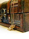 Old treasure chest detail of with gold chain over white background Royalty Free Stock Photos