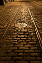 Old trolley tracks and cobblestones Royalty Free Stock Photo