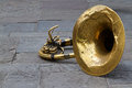 Old tuba a well used lies on the ground in jackson square new orleans Stock Images