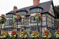 Old tudor building a at the entrance to the castle in shrewsbury england uk showing wooden beams and leaded glass windows and Royalty Free Stock Photo