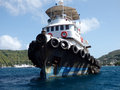 An old tug boat in the windward islands a close up of a strong sturdy at anchor shelter of admiralty bay bequia Stock Photos