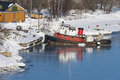 Old tugboat tug at the pier in winter Royalty Free Stock Images