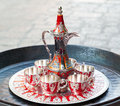 Old turkish coffee service with red and golden details Stock Photos