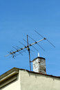 Old tv antenna on the roof of a building Royalty Free Stock Image