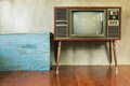Old tv retro television with blue wood container in the room Stock Photos