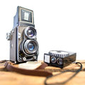 Old twin-lens reflex camera with light meter Royalty Free Stock Photo