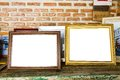old two photo frames on the wooden table. Royalty Free Stock Photo