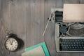 Old typewriter and alarm clock