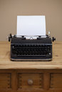 Old typewriter and blank paper an retro with a piece of for you to add your own text Royalty Free Stock Photos