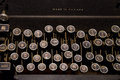 Old typewriter with irregular keyboard Stock Photography