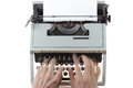 Old typewriter over white background Royalty Free Stock Image