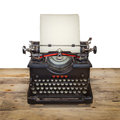 Old typewriter on a vintage wooden floor Stock Photo