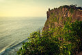 Old uluwatu temple photo of the beauty of the sacred was taken from the edge of a steep cliff in bali indonesia Royalty Free Stock Photo