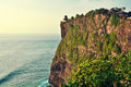 Old uluwatu temple photo of the beauty of the sacred was taken from the edge of a steep cliff in bali indonesia Royalty Free Stock Photos