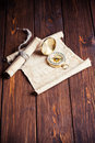 Old unrolled map rolled and compass on wooden table Stock Photos