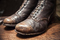 Old used boots made of genuine leather close up photo shoes with selective focus Stock Photo