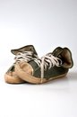 Old used green sneakers on white background Stock Photo