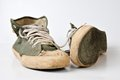 Old used green sneakers on white background Royalty Free Stock Photography