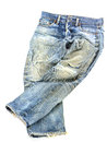 Old used jeans trousers isolated Royalty Free Stock Photo