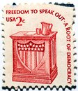 An old used postage stamp printed in USA shows Freedom to speak out - Speaker\'s Stand, 2 cents 1975 Royalty Free Stock Photo
