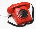 Old used red telephone Stock Images