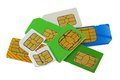 Old and used sim cards a group of subscriber identity module one is bent broken Stock Image