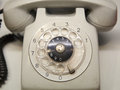 Old used telephone with rotary dial Royalty Free Stock Photo