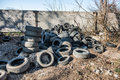 Old used tires dump in the city Stock Photography