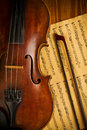 Old used violin and note close up Royalty Free Stock Image