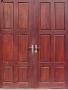 Old used weathered abandoned red brown colour hard wood double door Royalty Free Stock Photo
