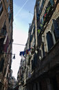 Old venetian alley over water Royalty Free Stock Photo