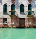 Old venetian house standing in water facade of rustic italy Stock Photography